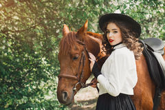 Woman in vintage dress with horse Royalty Free Stock Photos