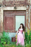 Woman in the vintage dress with old suitcase Stock Photo