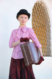 Woman in vintage dress with suitcase Stock Photos