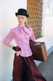 Woman in vintage dress with suitcase Royalty Free Stock Photo