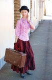 Woman in vintage dress with suitcase Stock Photography