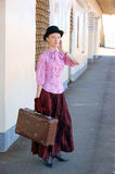 Woman in vintage dress with suitcase Royalty Free Stock Photos