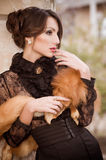 Woman in vintage fashion clothes Stock Photography