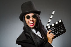 The woman with vintage hat and movie board Royalty Free Stock Photography