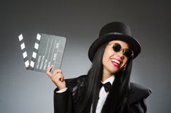 The woman with vintage hat and movie board Stock Photos