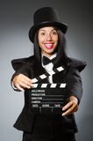 The woman with vintage hat and movie board Stock Photography
