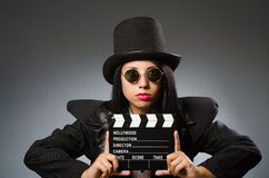 The woman with vintage hat and movie board Royalty Free Stock Photos