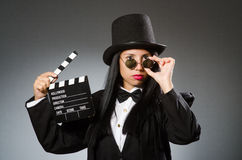 The woman with vintage hat and movie board Stock Image