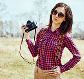 Woman with vintage photo camera in spring Stock Photo