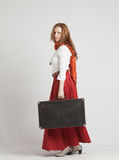 Woman in vintage red skirt with suitcases Royalty Free Stock Photos
