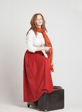 Woman in vintage red skirt with suitcases Royalty Free Stock Photo