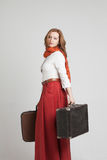 Woman in vintage red skirt with suitcases Stock Photos