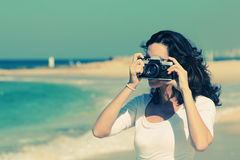 Woman with vintage retro camera Stock Images