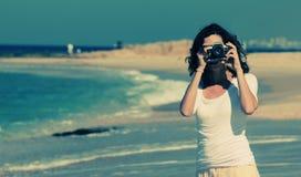 Woman with vintage retro camera Stock Image