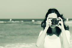 Woman with vintage retro camera Stock Photography