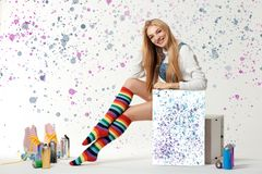 Woman with vintage roller skates, spray paint cans and beautiful picture. On patterned background stock images