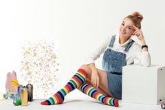 Woman with vintage roller skates, spray paint cans and beautiful picture stock images