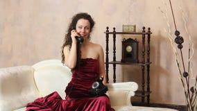 Woman in vintage room phone speaking stock video