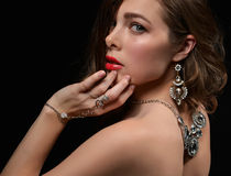 Woman with vintage silver diamond pendant jewelry and earrings Stock Images