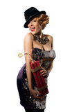 Woman in vintage style dress and hat holding dynamite Stock Images