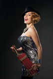 Woman in vintage style dress and hat holding dynamite Royalty Free Stock Images