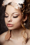 Woman in a vintage style with luxurious make-up Royalty Free Stock Photos
