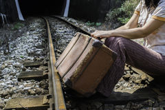 Woman and vintage suitcase on railway road Royalty Free Stock Photography