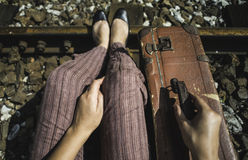 Woman and vintage suitcase on railway road Royalty Free Stock Image