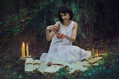 Woman with vintage toy in dark forest royalty free stock images