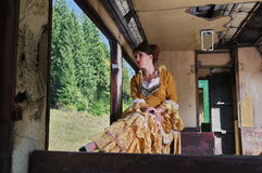 Woman on a vintage train near the window Royalty Free Stock Photo