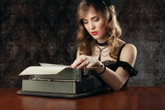 Woman and vintage typewriter. Retro portait, woman and vintage typewriter Stock Photography