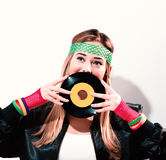 Woman with a vinyl record in 1980`s fashion Stock Photography