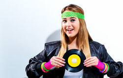 Woman with a vinyl record in 1980`s fashion. On a white background royalty free stock images