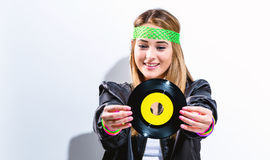 Woman with a vinyl record in 1980`s fashion Stock Images