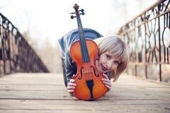 Woman with viola on the bridge Royalty Free Stock Photos