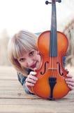 Woman with viola on the bridge Stock Photo