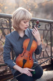 Woman with viola on the bridge Royalty Free Stock Photography
