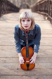 Woman with viola on the bridge Royalty Free Stock Image