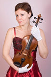 Woman with the viola Stock Image