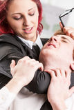 Woman violently abusing of a man colleague Royalty Free Stock Image
