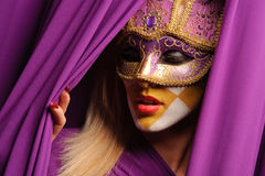 Woman in violet carnival mask Royalty Free Stock Photo