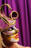 Woman in violet carnival mask Stock Images