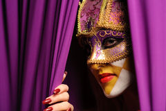 Woman in violet carnival mask Stock Image