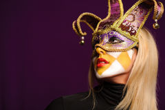 Woman in violet carnival mask Stock Photos