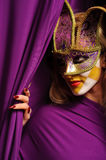 Woman in violet carnival mask Royalty Free Stock Images