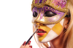Woman in violet carnival mask Royalty Free Stock Image