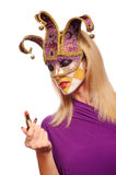 Woman in violet carnival mask Stock Photography