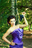 Woman in violet fashion dress Royalty Free Stock Photo