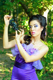 Woman in violet fashion dress Royalty Free Stock Images