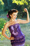 Woman in violet fashion dress Stock Images